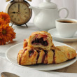 Mini cherry strudel with a cup of coffee — Stock Photo