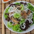 Rice noodles with mushrooms in breadcrumbs in lettuce leaves — Stock Photo #16041307