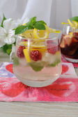 Fresh homemade lemonade with mint and raspberries — Stock Photo