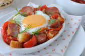 Stew with sausage and egg — Stock Photo