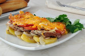 Meat and cheese with potatoes — Stock Photo