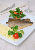 Baked fillet of sea bass — Stock Photo