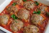 Meatballs with herbs and tomato sauce in the pan — Stock Photo