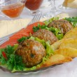 Meatballs with herbs and potatoes - Stock Photo