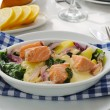 Salmon with potatoes and spinach cream sauce - Stock Photo