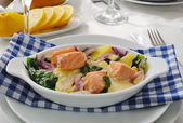 Salmon with potatoes and spinach cream sauce — Stock Photo