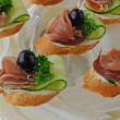 Stock Photo: Canapes with ham