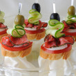Stock Photo: Canapés with salami