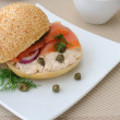 Salmon sandwich and a cup of coffee — Stock Photo
