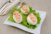 Eggs stuffed with salmon pate — Stock Photo
