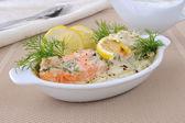 Salmon with cream and lemon sauce — Stock Photo