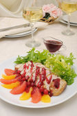 Sliced baked fillet with cranberry sauce — Stock Photo
