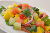 Norwegian salmon ceviche with mango and coriander — Stock Photo