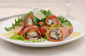 Rolls of jamon with blue cheese in lettuce leaves and parmesan — Stock Photo