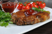 Pork steak with ketchup — Stok fotoğraf