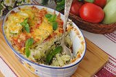 Casserole of pasta with zucchini and tomato , cheese — Stock Photo