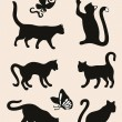 Six cat silhouettes isolated on coffee latte background — Stock Vector