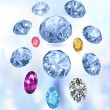 Colored gems on light blue background — Stock Photo