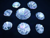 Diamonds on dark blue background — Stock Photo