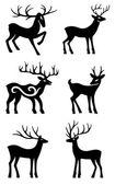 Six deer standing vector silhouettes — Stock Vector