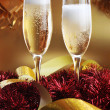 Christmas ribbons and two glasses with champagne — Stock Photo
