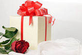 Present box with rose — Stock Photo