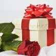 Present box with rose — Stock Photo #13562355