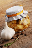 Jar of pickled garlic — Stock Photo
