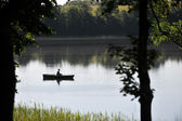 Fisherman in boat — Stock Photo