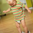 Boy  in big shoes - Stock Photo