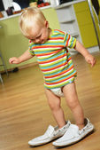 Boy in big shoes — Stock Photo