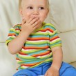 Boy eating sweets — Stock Photo