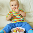 Boy eating sweets — Stock fotografie