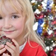 Royalty-Free Stock Photo: Girl near Christmas fir-tree