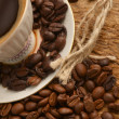 Coffee beans and cup - Stock Photo