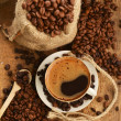 Coffee beans and cupCoffee beans and cup - Stock Photo