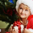Girl in santa cap — Stock Photo #14811385