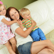 Mother and her children — Stock Photo #15431879