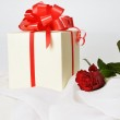 Present box with rose — Stock Photo #15431945