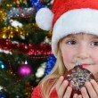 Girl near Christmas fir-tree — Stock Photo #16020871