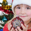 Girl near Christmas fir-tree - Stock Photo