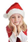Dívka v santa čepice — Stock fotografie