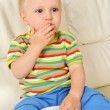 Boy eating sweets - Stock Photo