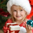 Girl in santa cap — Stock Photo #16285065