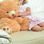 Girl with teddy bear — Stock Photo #16993695