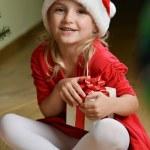 Girl in santa cap — Stock Photo #16993859