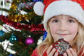 Girl near Christmas fir-tree — Stock Photo