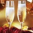 Christmas ribbons and two glasses with champagne — Stockfoto