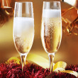 Royalty-Free Stock Photo: Christmas ribbons and two glasses with champagne