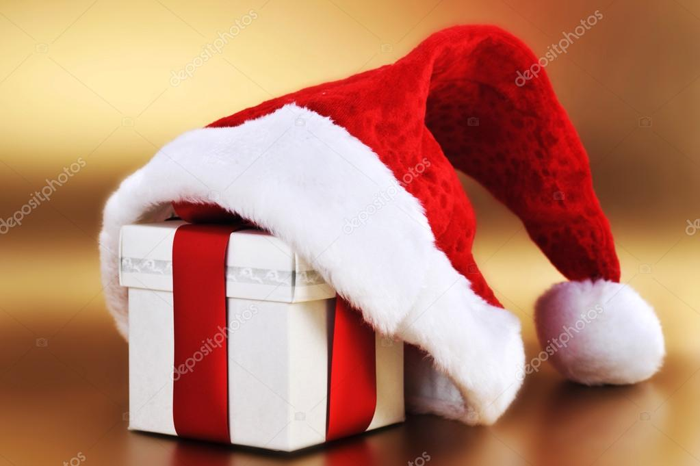 Christmas present with santa hat close up — Stock Photo #17590879